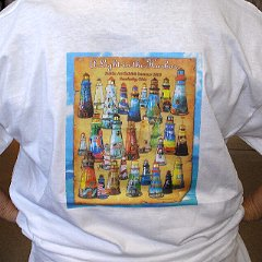 T-shirt decorated w/ array of lighthouses on back
